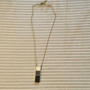 Black, white, and grey pendent necklace